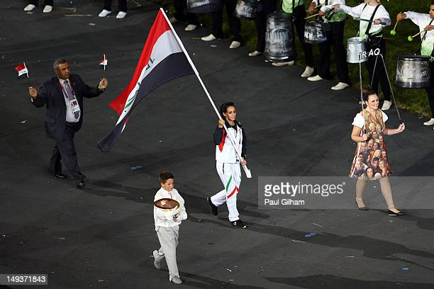 Dana Abdul Razak of the Iraq Olympic athletics team carries her country's flag during the Opening Ceremony of the London 2012 Olympic Games at the...