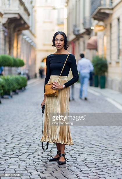 Dana al Khalifa wearing a golden skirt and black shirt a Miu Miu shoes during Milan Fashion Week Spring/Summer 2017 on September 24 2016 in Milan...