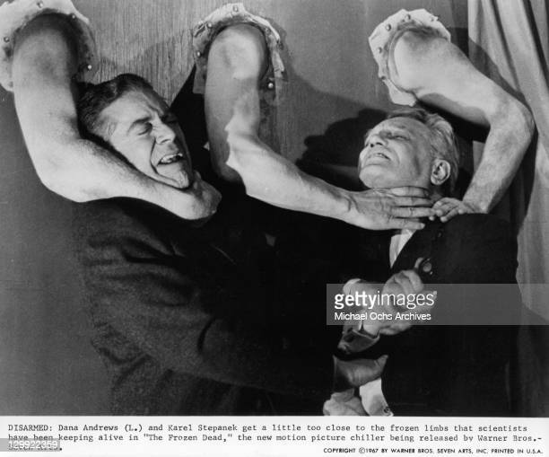 Dana Andrews And Karel Stepanek are choked by frozen limbs in a scene from the film 'The Frozen Dead' 1967