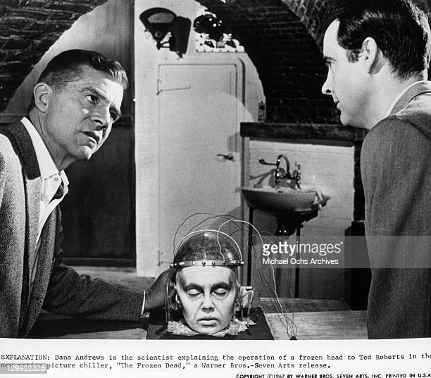 Dana Andrews And Ted Roberts discussing frozen head in a scene from the film 'The Frozen Dead' 1967