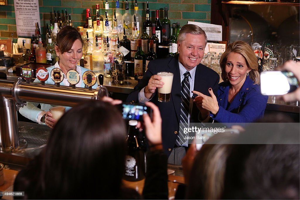 Dana Bash, Senator Lindsey Graham, and his sister Darline Graham Nordone serve guests prior to CNN's Politics On Tap at Walnut Brewery on October 27, 2015 in Boulder, Colorado. 25763_001