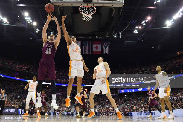 Dana Batt of the Colgate Raiders and Grant Williams of the Tennessee Volunteers fight for a rebound Raiders in the first round of the 2019 NCAA...
