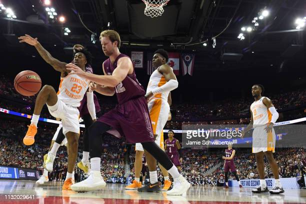 Dana Batt of the Colgate Raiders and Jordan Bowden of the Tennessee Volunteers fight for a loose ball in the first round of the 2019 NCAA Photos via...