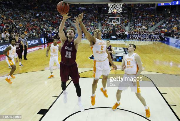 Dana Batt of the Colgate Raiders battles for the ball with Grant Williams of the Tennessee Volunteers during the first half in the first round of the...
