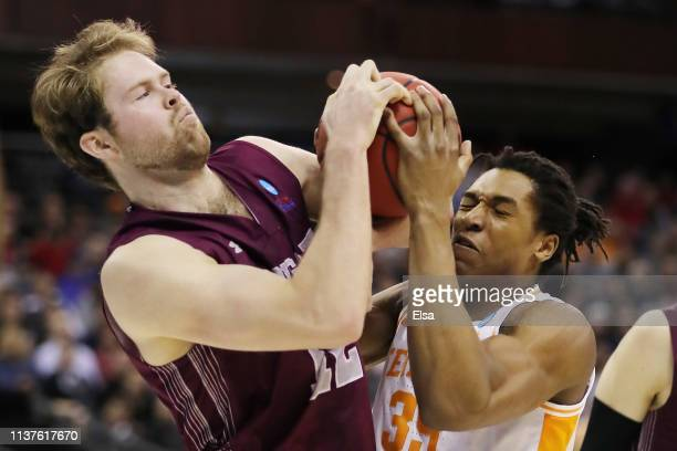Dana Batt of the Colgate Raiders battles for the ball with Yves Pons of the Tennessee Volunteers during the first half in the first round of the 2019...