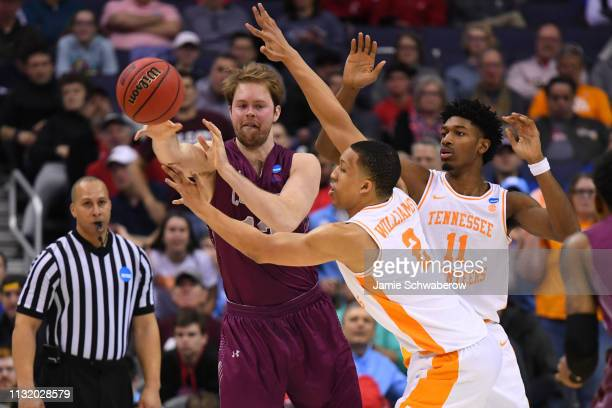 Dana Batt of the Colgate Raiders passes the ball around Grant Williams and Kyle Alexander of the Tennessee Volunteers in the first round of the 2019...