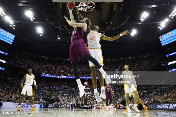Dana Batt of the Colgate Raiders shoots the ball against Kyle Alexander of the Tennessee Volunteers in the first round of the 2019 NCAA Men's...