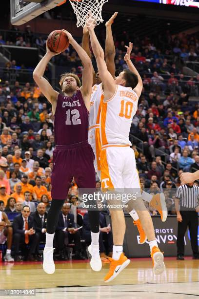 Dana Batt of the Colgate Raiders takes a shot as John Fulkerson of the Tennessee Volunteers defends in the first round of the 2019 NCAA Photos via...