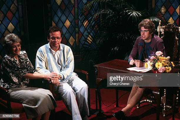 Dana Carvey right plays the Church Lady in a sketch with Jim and Tammy Faye Bakker played by Phil Hartman and Jan Hooks