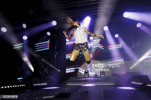 Dana 'Danasaurus Rex' Schiemann from Canada performs during the Air Guitar World Championships final in Oulu Finland on August 24 2018 / Finland OUT