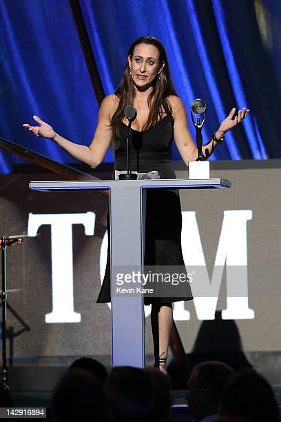Dana Dowd accepts an award on behalf of Tom Dowd on stage during the 27th Annual Rock And Roll Hall Of Fame Induction Ceremony at Public Hall on...