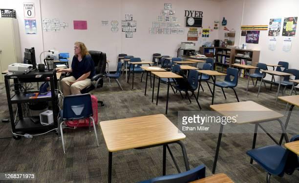 Dana Dyer teaches an online seventh grade algebra class from her empty classroom at Walter Johnson Junior High School on the first day of distance...
