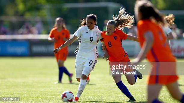 Dana Foederer of the Netherlands challenges Gia Corley of Germany during the U15 girl's international friendly match between Germany and Netherlands...