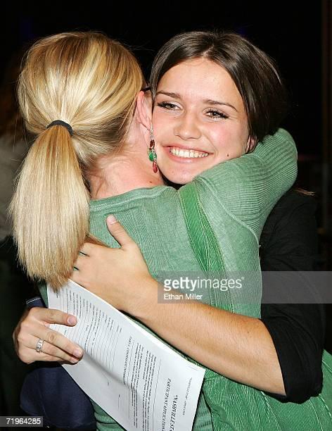 Dana Gibbons of Utah hugs her cousin Megan Gibbons of Utah after Dana Gibbons earned a callback audition for the USA Network's 'Nashville Star'...