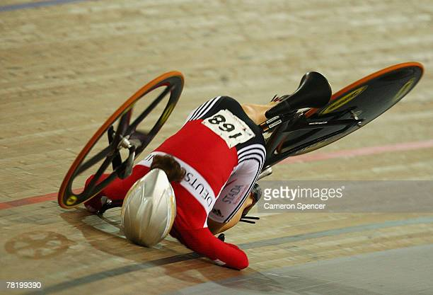 Dana Gloss of Germany falls to the track as her front forks snap off her bicycle frame during the women's team sprint bronze medal race during day...