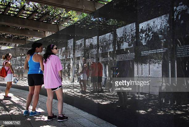 Dana Greenberg Tricia Miner and Ilyse Greenberg look at pictures on display as they visit the Holocaust Memorial during Yom HaShoahHolocaust...