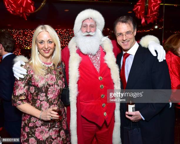 Dana Hammond Santa Claus and Patrick Stubgen attend A Christmas Cheer Holiday Party 2017 Hosted by George Farias and Anne and Jay McInerney at The...