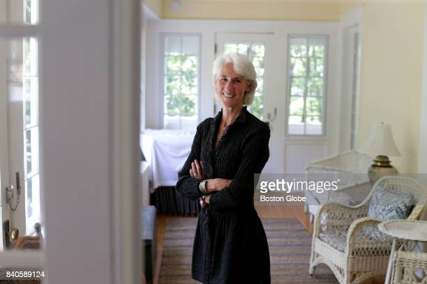 Dana Hawkes poses for a portrait at the TS Eliot House in Gloucester MA which she used to own on Aug 16 2017