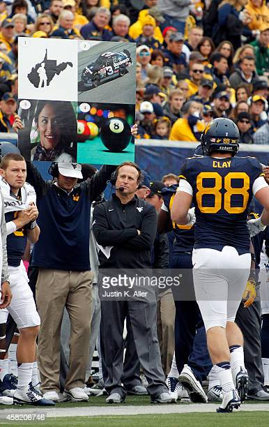 Dana Holgorsen of the West Virginia Mountaineers looks on during the game against the Baylor Bears on October 18 2014 at Mountaineer Field in...