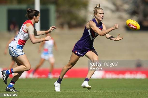 Dana Hooker of the Dockers handballs during the round five AFLW match between the Fremantle Dockers and the Western Bulldogs at Fremantle Oval on...