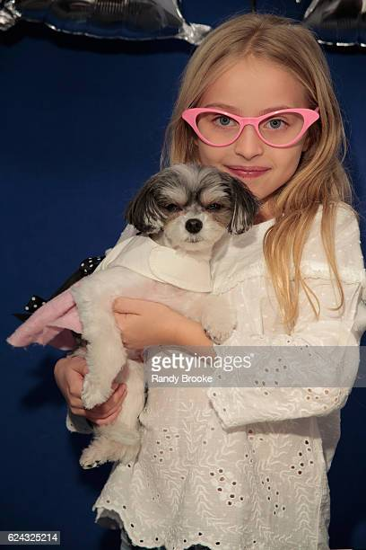 Dana Humphrey poses with Tinkerbelle during Tinkerbelle The Dog's Sock Hop Birthday on November 18, 2016 in New York City.