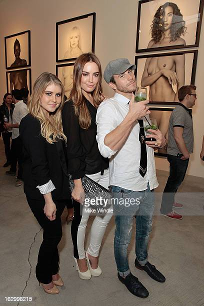 Dana Johnson Beau Dunn and Gregory Siff attend the Samuel Bayer Ace Gallery Exhibit Opening presented by Panavision at Ace Gallery on March 2 2013 in...