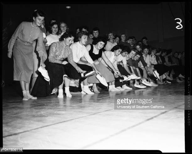 Dana Junior High School in San Pedro remove shoes to prevent damaging floor of new gym 3 January 1956 Judy MendenhallElaine PanousisJoyce...