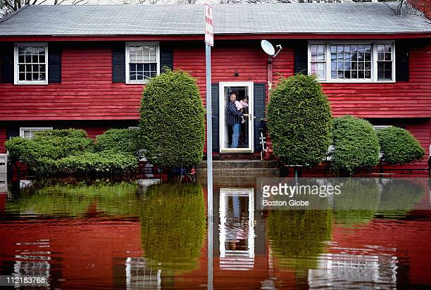 Dana Knight and daughter Emily surveyed the waters surrounding their home on Auburn Street in Framingham The Sudbury River which runs behind the...