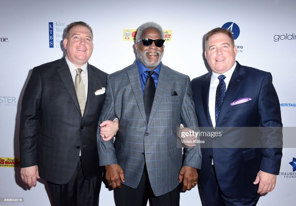 Dana Pump, Earl Campbell and David Pump attend the 17th Annual Harold & Carole Pump Foundation Gala at The Beverly Hilton Hotel on August 11, 2017 in Beverly Hills, California.