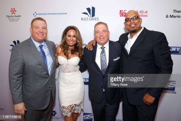 Dana Pump Rebecca justice David Pump and David Justice attend the 19th Annual Harold and Carole Pump Foundation Gala at The Beverly Hilton Hotel on...