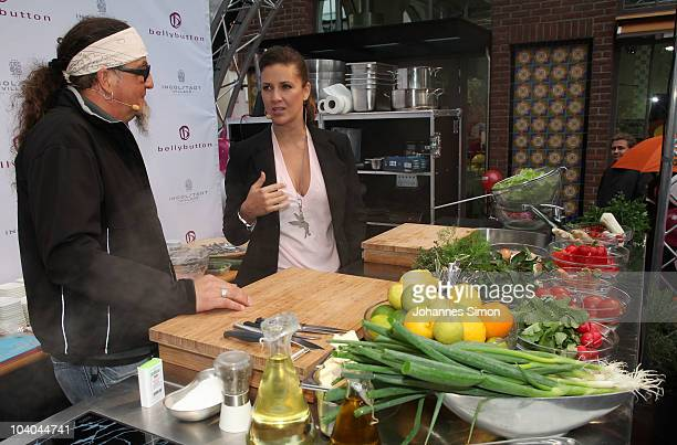 Dana Schweiger and chef Stefan Marquard perform a cook show during a Bellybutton outlet store opening at Ingolstadt Village on September 13 2010 in...