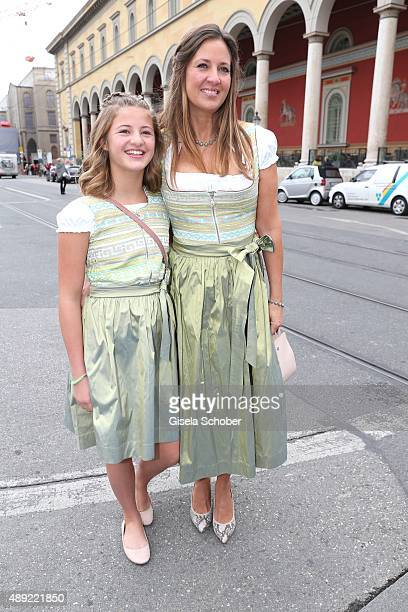 Dana Schweiger wearing a Dirndl by the label Owloon and her daughter Emma Schweiger during the 'Fruehstueck bei Tiffany' at Tiffany Store ahead of...