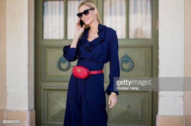 Dana Spector wearing blue dress Balenciaga shoes Gucci fanny bag is seen during Tel Aviv Fashion Week on March 11 2018 in Tel Aviv Israel