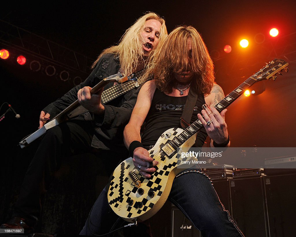 Dana Strum and Jeff Blando (R) of the Vince Neil band perform at Seminole Casino Coconut Creek on December 15, 2012 in Coconut Creek, Florida.