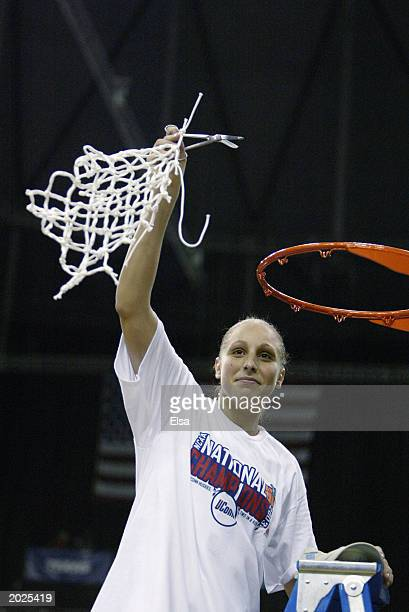 Dana Tauasi of the University of Connecticut Huskies cuts down the net after defeating the University of Tennessee Lady Volunteers in the NCAA...