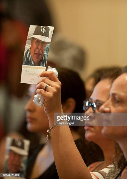 Dana Valle of Avondale Arizona and Stacy Acevedo of Youngtown Arizona hold pictures of their father Cecil Valle at a forum at the Burton Barr Central...