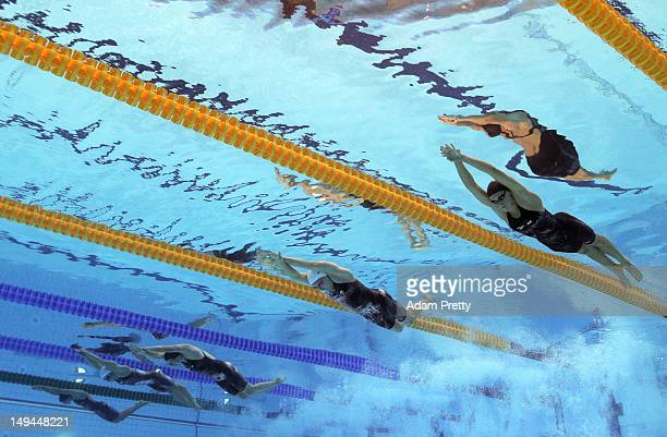 Dana Vollmer of the United State Alicia Coutts of Australia and Claire Donahue of the United States compete in the second semifinal heat of the...