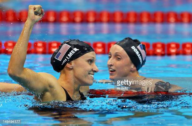Dana Vollmer of the United States celebrates with teammate Claire Donahue after winning the gold medal and setting a new world record time of 55.98...