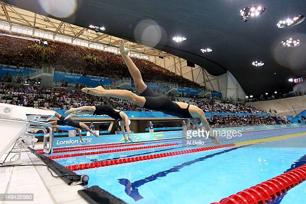 Dana Vollmer of the United States dives off of the starting block as she competes in heat six of the Women's 100m Butterfly on Day One of the London...