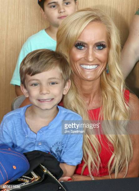Dana Warrior poses with a wish kid at the the WWE Superstars Surprise MakeAWish Families at One World Observatory on August 19 2017 in New York City