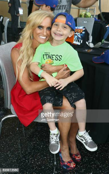 Dana Warrior poses with a wish kid at the WWE Superstars Surprise MakeAWish Families at One World Observatory on August 19 2017 in New York City