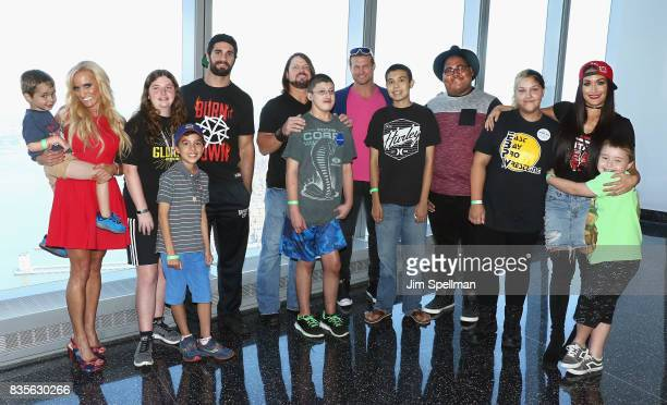 Dana Warrior Seth Rollins AJ Styles Dolph Ziggler and Nikki Bella pose with wish kids at the WWE Superstars Surprise MakeAWish Families at One World...