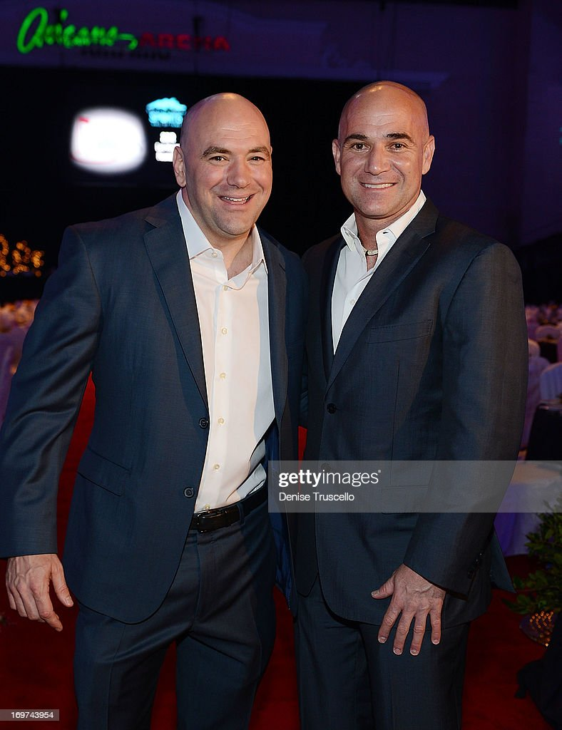 Dana White (L) and Andre Agassi get inducted into the 2013 Southern Nevada Sports Hall of Fame at the Orleans Arena on May 31, 2013 in Las Vegas, Nevada.