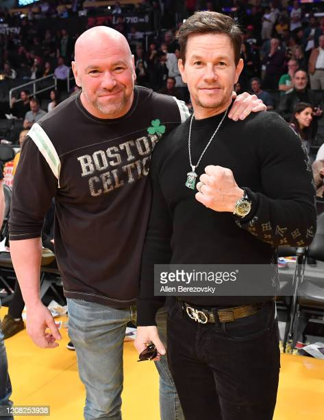 Dana White and Mark Wahlberg attend a basketball game between the Los Angeles Lakers and the Boston Celtics at Staples Center on February 23, 2020 in...