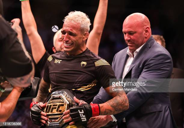 Dana White places the belt on Charles Oliveira after he defeated Michael Chandler during their Championship Lightweight Bout of UFC 262 at Toyota...