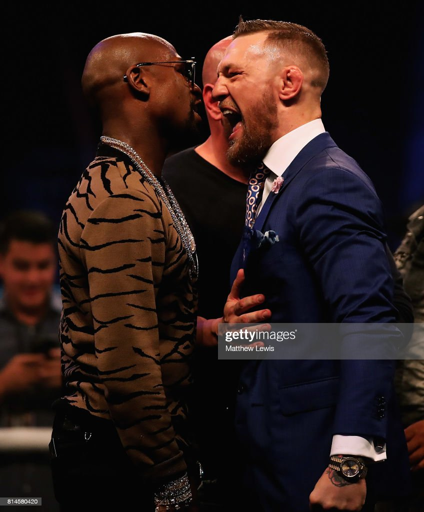 Dana White splits Floyd Mayweather Jr. and Conor McGregor apart during the Floyd Mayweather Jr. v Conor McGregor World Press Tour at SSE Arena on July 14, 2017 in London, England.