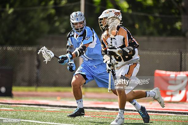 Dana Wilber of the Ohio Machine defends against Jordan Wolf of the Rochester Rattlers on August 1, 2015 at Selby Stadium in Delaware, Ohio. Rochester...
