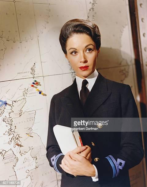 Dana Wynter portrays Anne Davis a Royal Navy WREN and intelligence officer in Sink the Bismarck