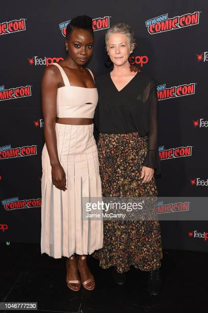 Danai Gurira and Melissa McBride attend the NYCC panel and fan screening of The Walking Dead episode 901 at The Theater at Madison Square Garden on...