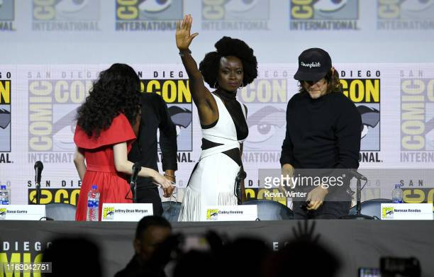 """Danai Gurira and Norman Reedus speak at """"The Walking Dead"""" Panel during 2019 Comic-Con International at San Diego Convention Center on July 19, 2019..."""